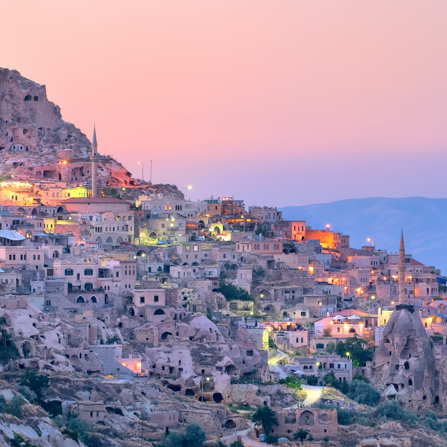 """Uchisar cave city in Cappadocia, Turkey on sunset"" stock image"