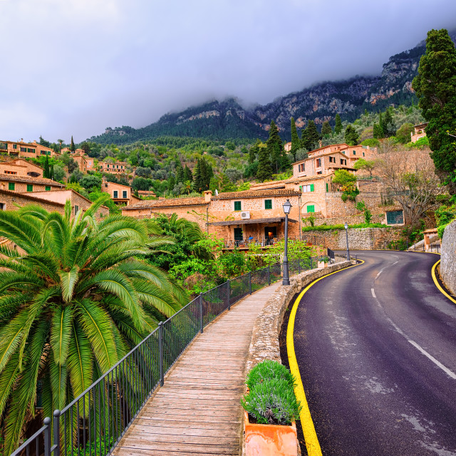 """Mountain road winding through little spanish town, Spain"" stock image"