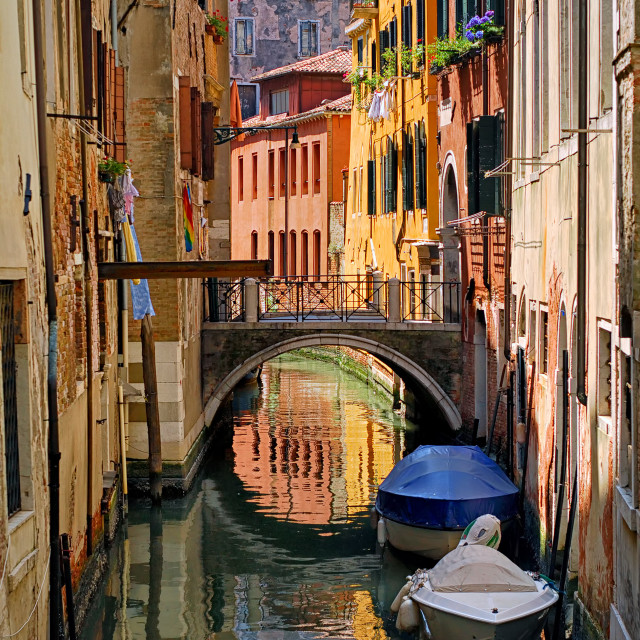 """Narrow channel street in Venice, Italy"" stock image"