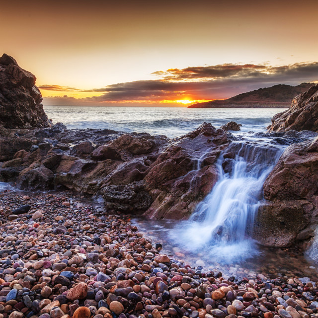 """Ocean cascade at Rotherslade"" stock image"
