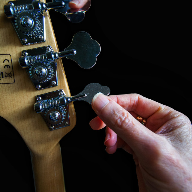 """Tuning an electric guitar."" stock image"