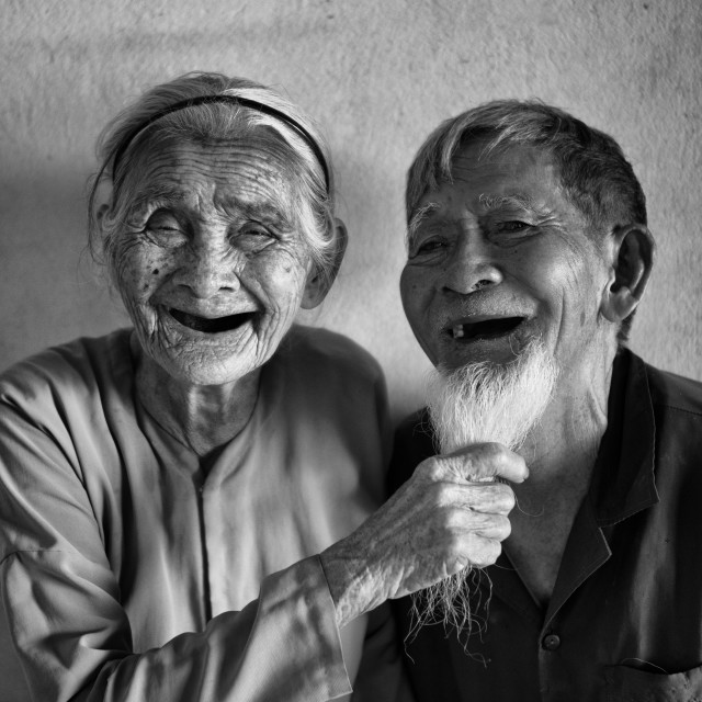 """Fun elderly married couple from Vietnam"" stock image"