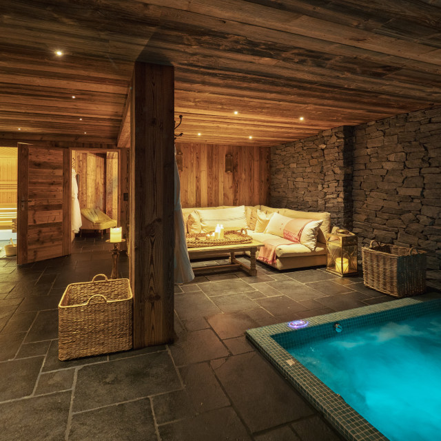 """a shot of a luxurious interior of a spa inside a ski chalet"" stock image"