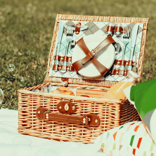 """Picnic Basket Food On White Blanket With Pillows And Soap Bubbles"" stock image"