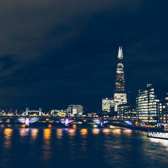 """Long exposure shot at night on River Thames with shard building"" stock image"