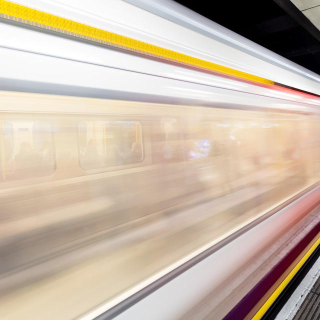 """Motion blurred moving train on London Underground tube station"" stock image"