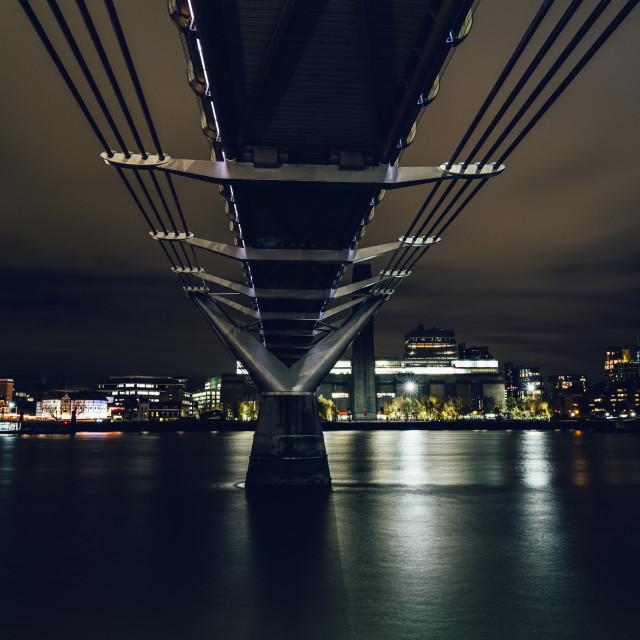 """Long exposure shot taken underneath the Millennium Bridge on Riv"" stock image"