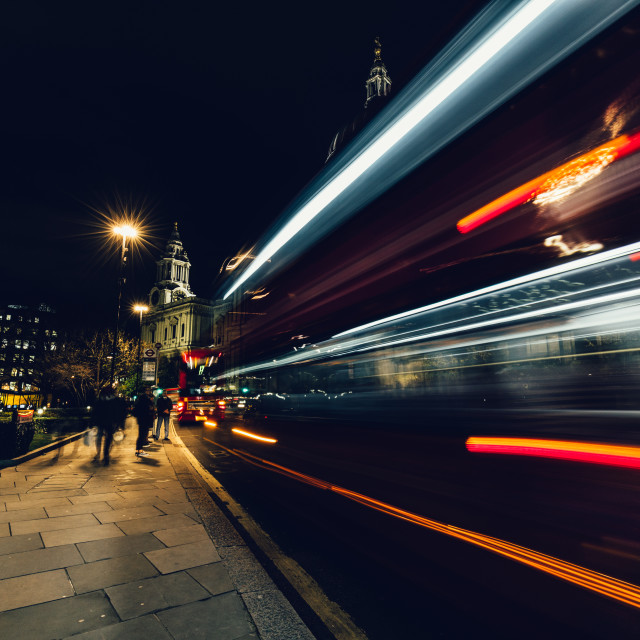 """City light trails of moving red London bus at night"" stock image"