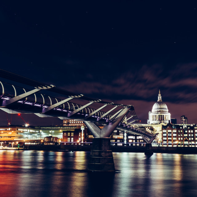 """Long exposure of Millennium Bridge and London city skyline on Ri"" stock image"