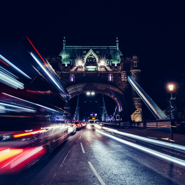 """City light trails of London bus traffic on Tower Bridge in Londo"" stock image"
