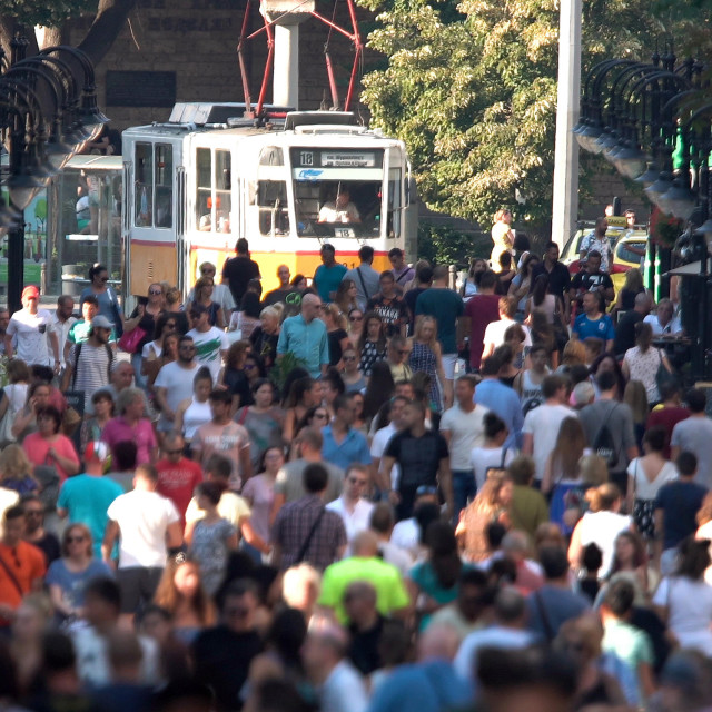 """Crowded street with people and a tram car"" stock image"