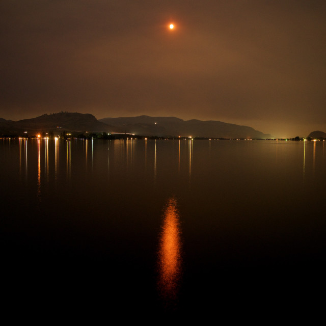 """""""Red Moon Over Lake Osoyoos"""" stock image"""