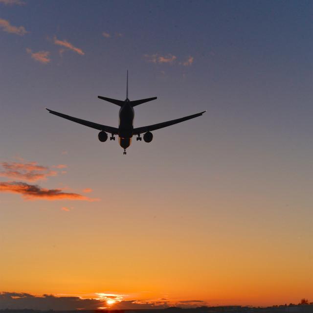 """""""Jetliner Sunset Landing"""" stock image"""