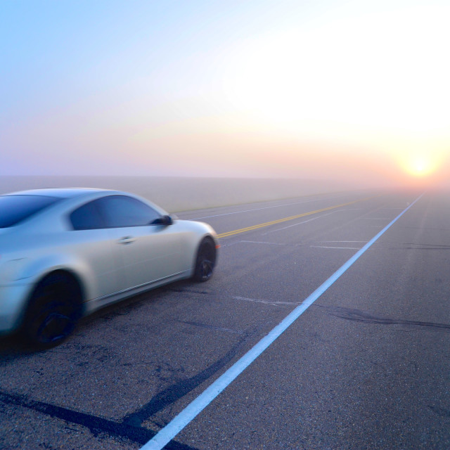 """Sports Car Racing into the Sunrise"" stock image"