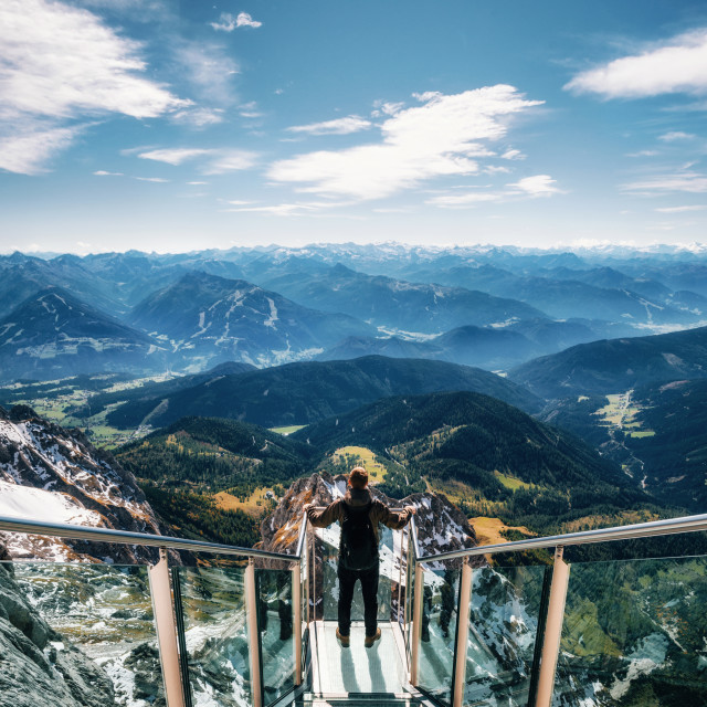 """Backpacker at the skywalk bridge in Dachstein, Austria"" stock image"