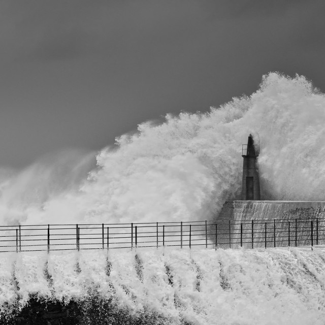 """Stormy wave over old lighthouse and pier of Viavelez."" stock image"