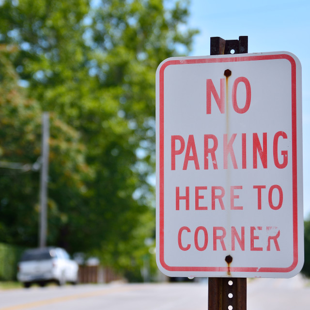 """No parking here to corner sign."" stock image"