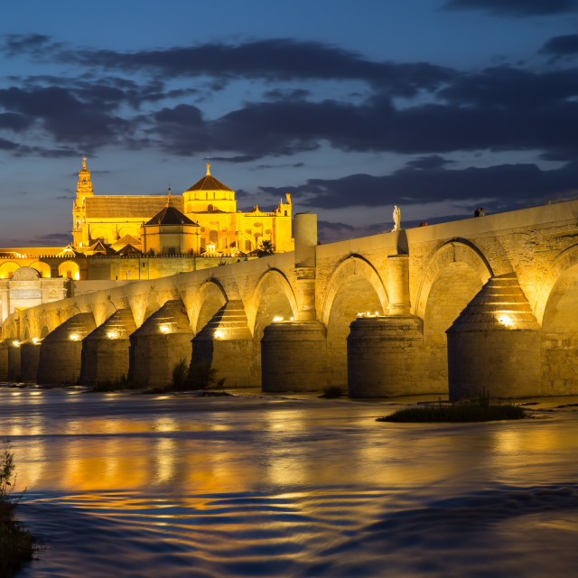 """The roman bridge of Cordoba with Cordoba's great cathedral and mosque at dusk."" stock image"