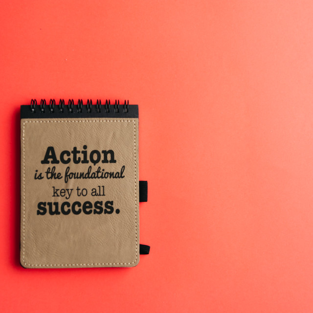 """""""Lay flat of notebook with motivational quote on pink background"""" stock image"""