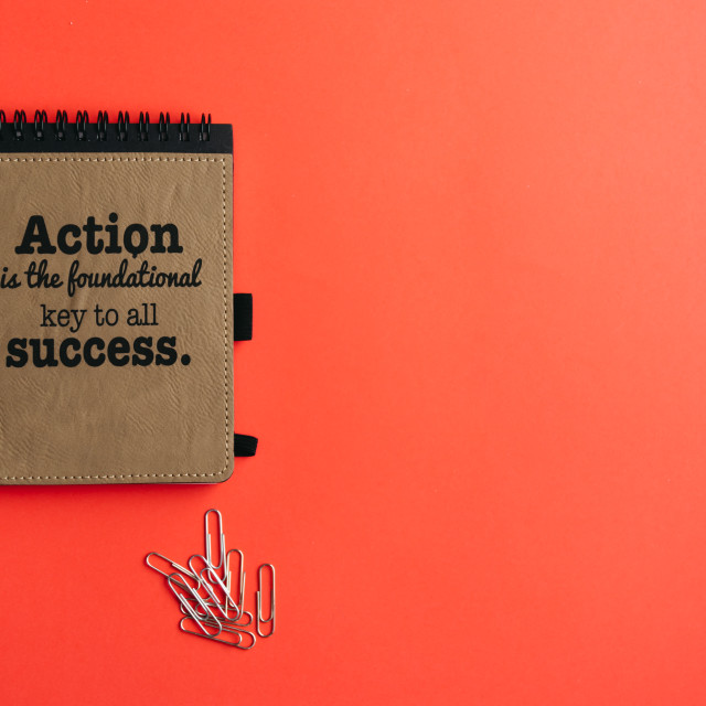 """""""Lay flat of notebook with motivational quote and paperclips on p"""" stock image"""