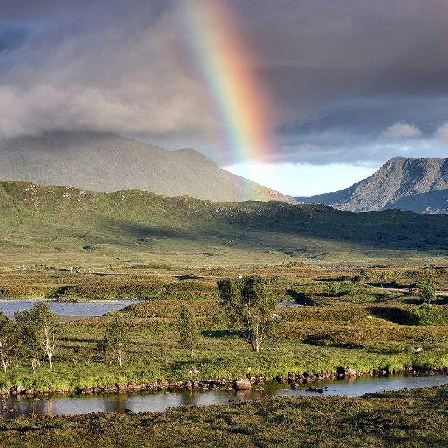 """""""An evening rainbow over Rannoch Moor at Loch Ba"""" stock image"""