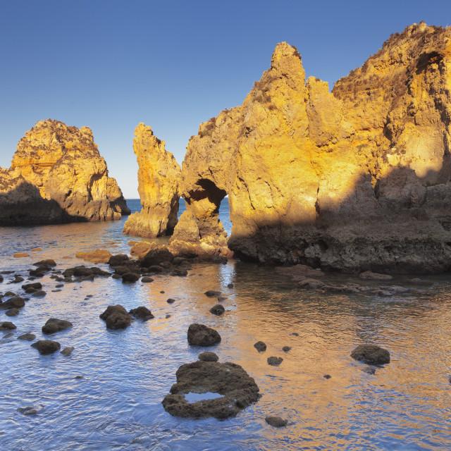 """""""Rocky coast at sunset, Ponta da Piedade Cape, near Lagos, Algarve, Portugal"""" stock image"""