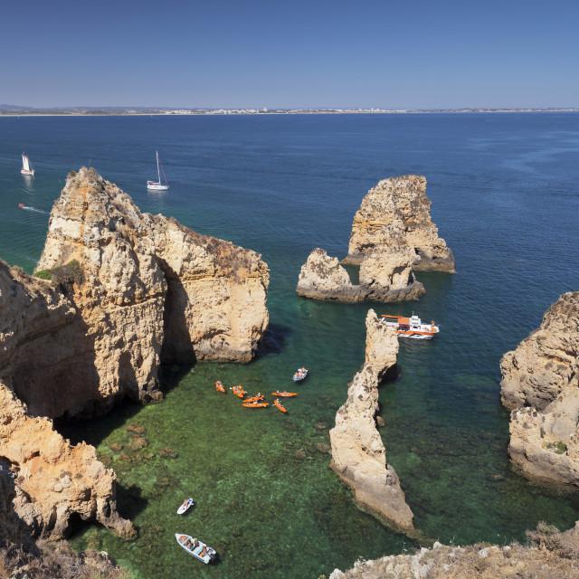 """Excursion boats at Ponta da Piedade Cape, near Lagos, Algarve, Portugal"" stock image"
