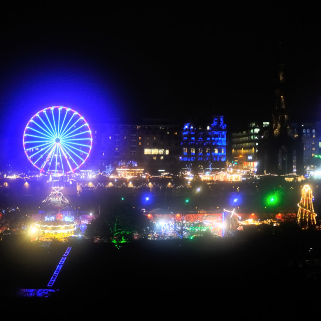 """Edinburgh Christmas Market lit up at night"" stock image"
