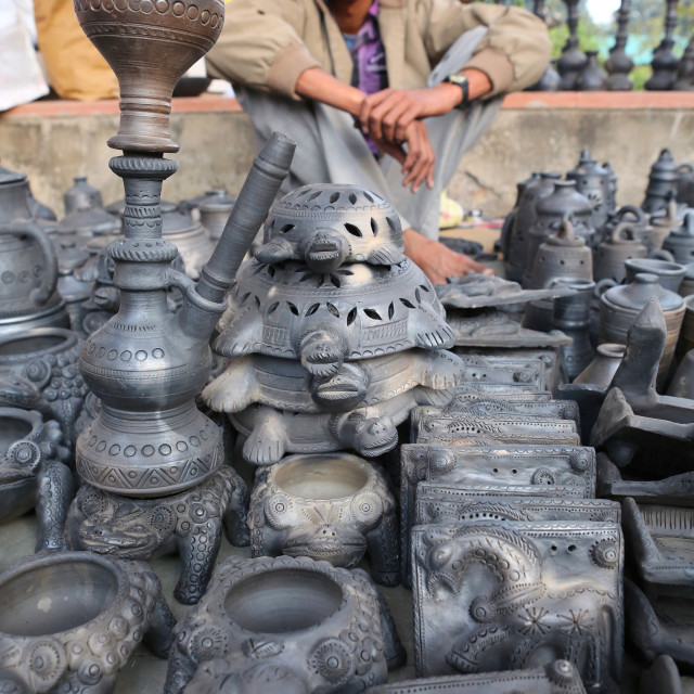 """A black clay pottery seller"" stock image"