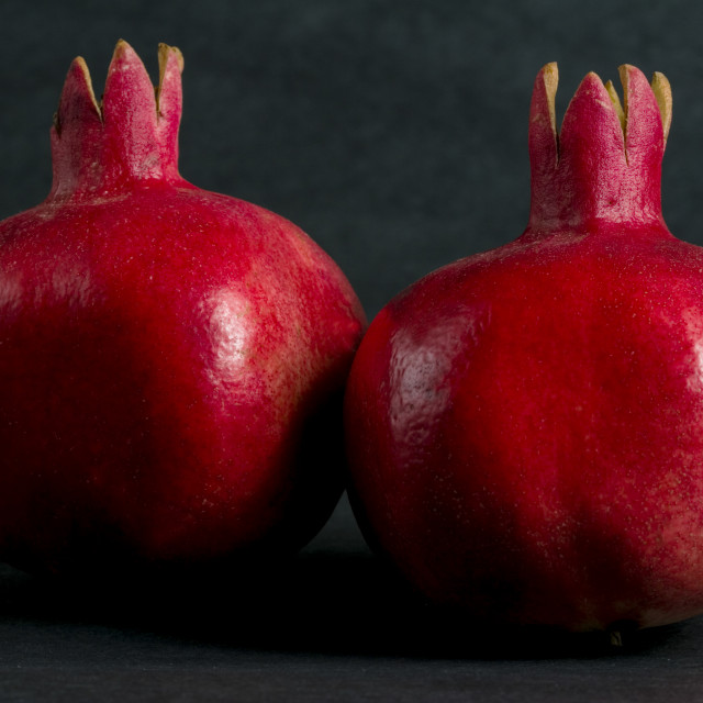 """Two ripe pomegranates"" stock image"