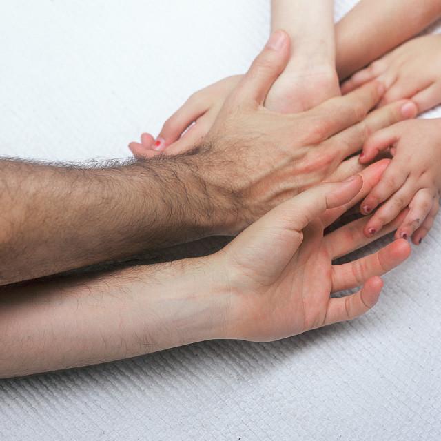 """entangled Family hands"" stock image"