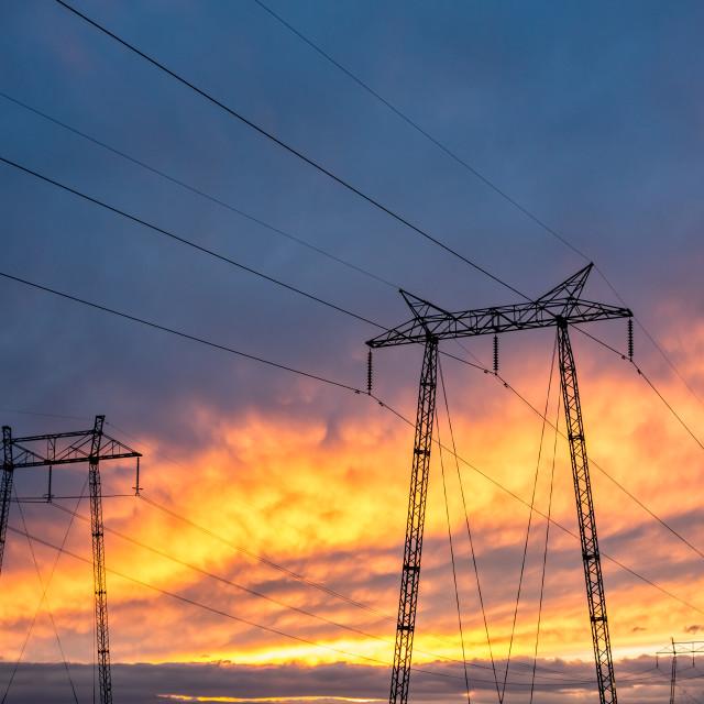 """High voltage pole towers burning sky sunset background"" stock image"