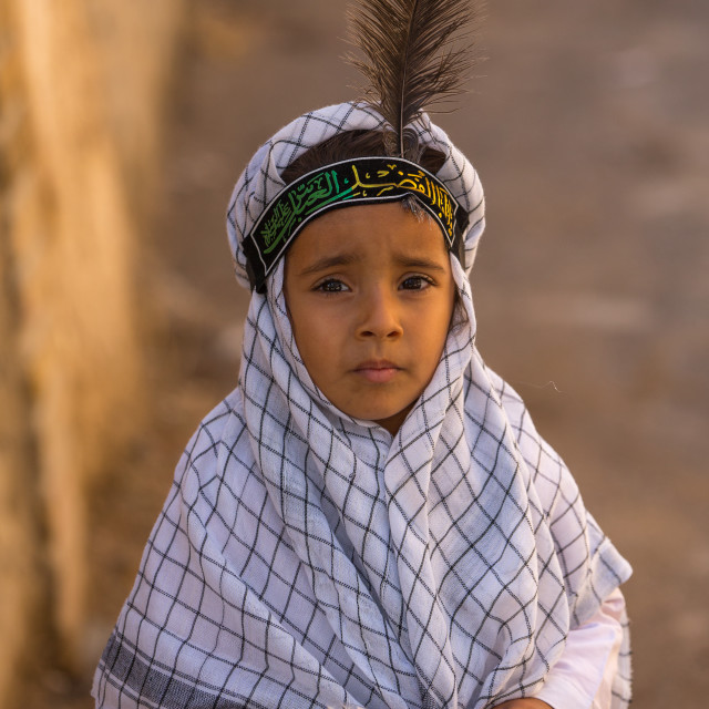 """An Iranian Shiite Boy With A Feather On The Head During Tasua Celebrations..."" stock image"