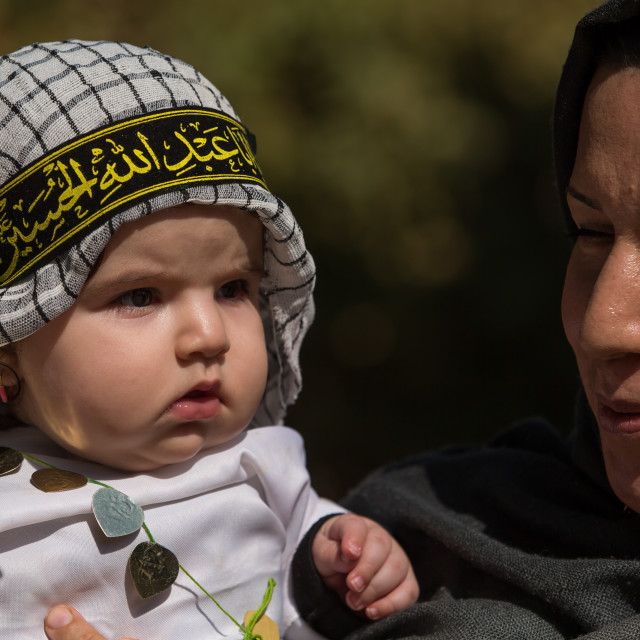"""""""An Iranian Shiite Mother And Her Child During Tasua Celebrations One Day..."""" stock image"""