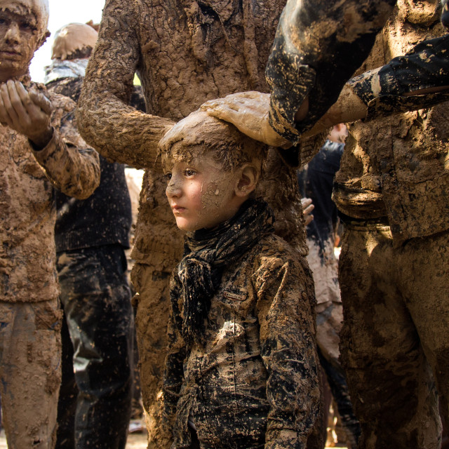 """Iranian Shiite Muslim Boy Covered In Mud By Adults During Ashura Day,..."" stock image"