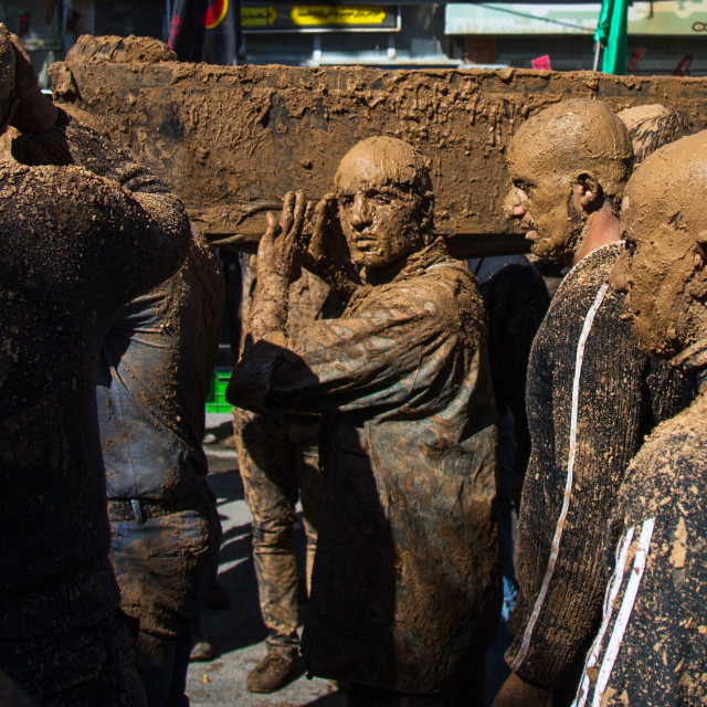 """Iranian Shiite Muslim Men Covered In Mud Carrying A Coffin During Ashura, The..."" stock image"