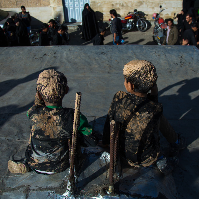 """Iranian Shiite Muslim Boys Covered In Mud, Chanting And Self-flagellating..."" stock image"