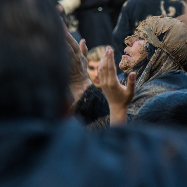 """Iranian Shiite Muslim Woman Covered In Mud Praying During Ashura Day,..."" stock image"