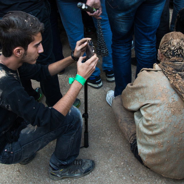 """Iranian Shiite Muslim Man Covered In Mud Taking Pictures During Ashura Day,..."" stock image"