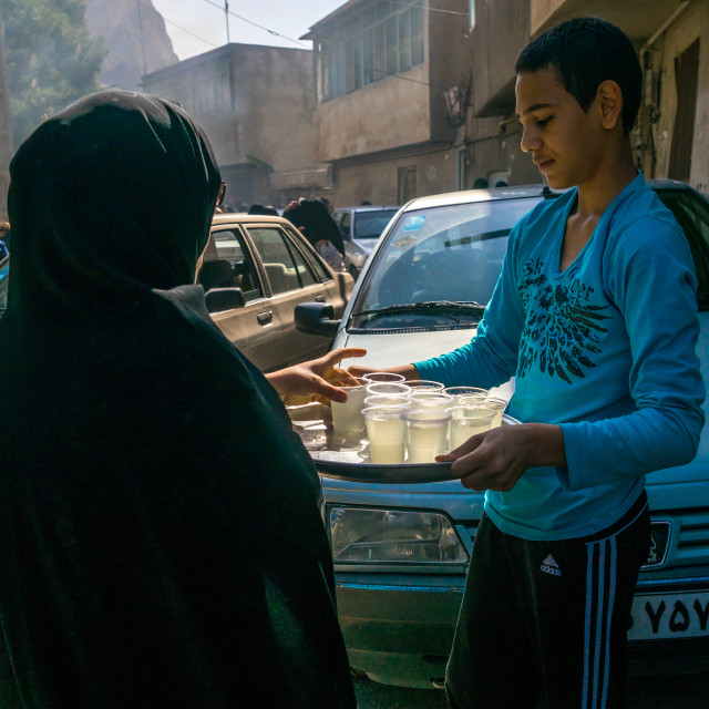 """Iranian Shiite Muslims Man Serving Nazri Tea Distributed Freely To Mourners..."" stock image"