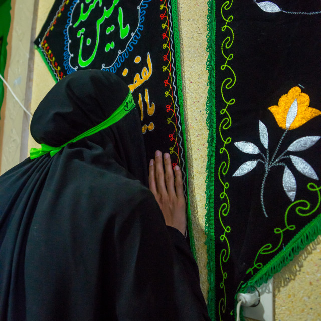 """Iranian Woman Kissing A Shiite Banner For Chehel Menbari Festival On Tasu'a..."" stock image"