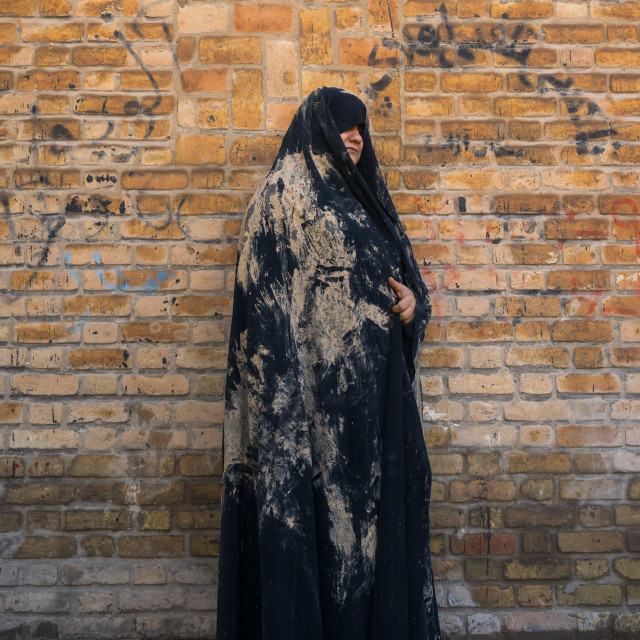 """An Elderly Iranian Shiite Woman Covered With Mud During The Chehel Manbar..."" stock image"
