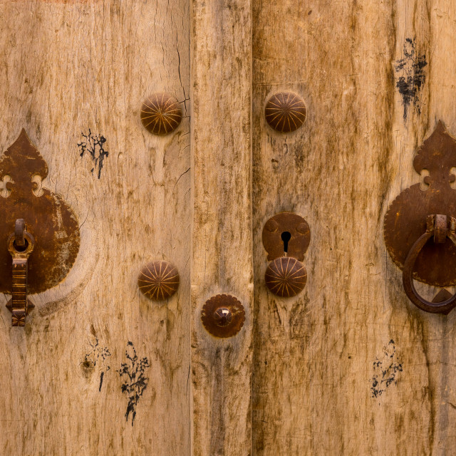 """""""Male And Female Doorknockers On An Old Wooden Door, Fars Province, Abarkooh,..."""" stock image"""