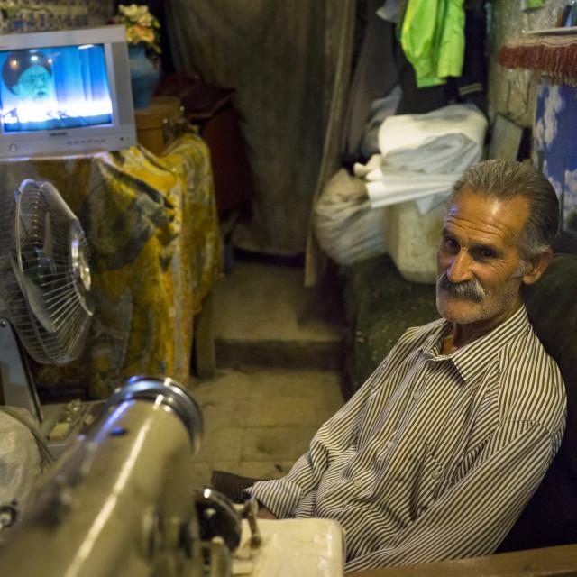 """""""Man Watching Television In The Bazaar, Kermanshah, Iran"""" stock image"""