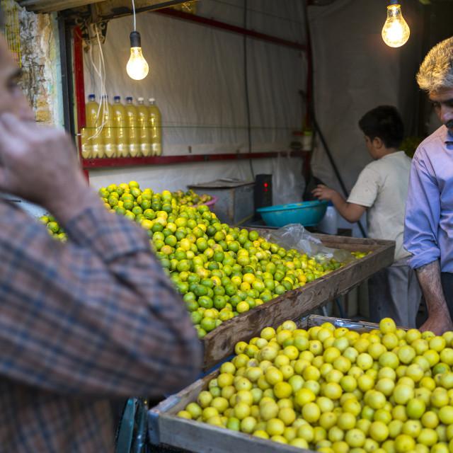 """""""Man Selling Lemons, In The Bazaar, Kermanshah, Iran"""" stock image"""