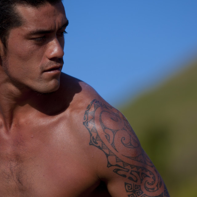 """Tattooed Man Ready For Canoe Competition At Anakena beach, Easter Island, Chile"" stock image"