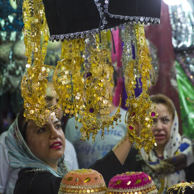 """Women Looking For Clothes In The Bazaar, Kermanshah, Iran"" stock image"