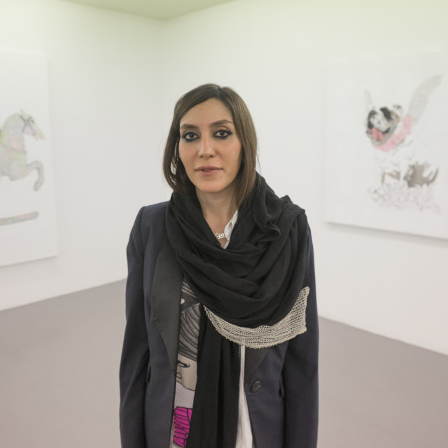 """""""Elnaz pausing in front of her painting, Shemiranat county, Tehran, Iran"""" stock image"""