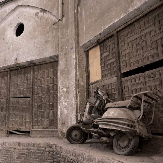 """Abandoned scooter in the bazaar, Isfahan province, Kashan, Iran"" stock image"