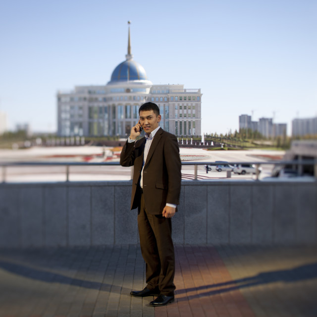"""Governement Employee In Front Of Presidential Palace, Astana, Kazakhstan"" stock image"